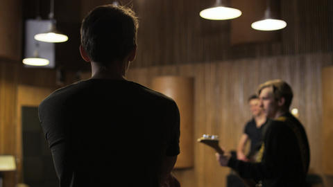 Two Men Playing Electric Guitars Seen From the Side Footage