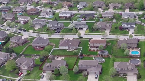 Flying over residential houses and yards along suburban street - Travel and leis Footage