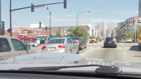 CHICAGO, ILLINOIS, USA - AUGUST 2015: Driving car in traffic on streets of downt Footage