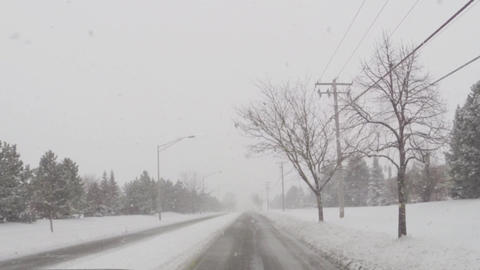 Driving car on slippery roads during cold winter snow storm Live Action