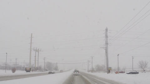Driving car on slippery roads during cold winter snow storm Footage
