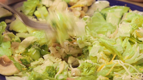 Man eating dinner salad prepared with fresh vegetables and lettuce Live Action