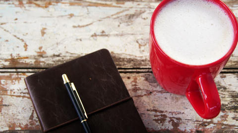 Coffee mug and diary on wooden plank Footage
