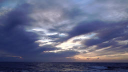Clouds late evening over ocean Footage