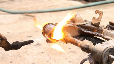 Upper Control Arm Bushings Removal with Fire Burning Stock Video Footage