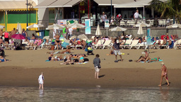 Spain Gran Canary Mogán 004 beach life with people on loungers and sand Footage
