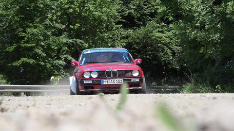 Red rally car passes a checkpoint in the wood 6979 Footage