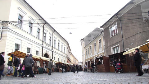 Stalls with goods carried out artisanal on one of city streets which stop buyers Live Action