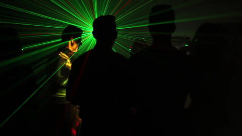 Teenager dancing at a party in a green laser light 9893b Footage