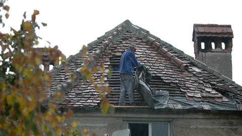 Workers covering a roof with tile 03 Footage