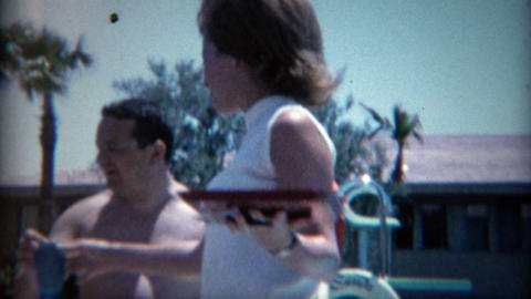 1965: 60's hairdo poolside cocktail waitress at the Sands Casino Footage