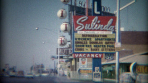 1965: 60's vintage strip motel restaurant and gas station business road signs Footage