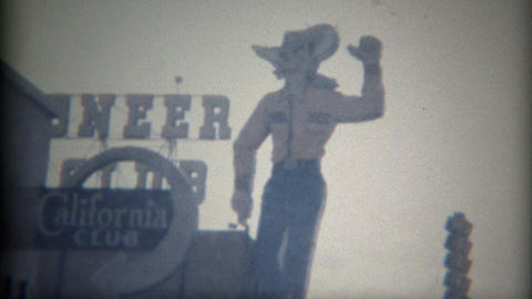1965: Pioneer Club Vegas Vick giant cowboy neon advertisement signage Footage