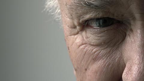 old man closeup footage: elderly man eye: pensive old man Footage