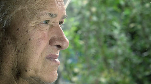 lonely and sad elderly man near the window: sad old man looking outside Live Action