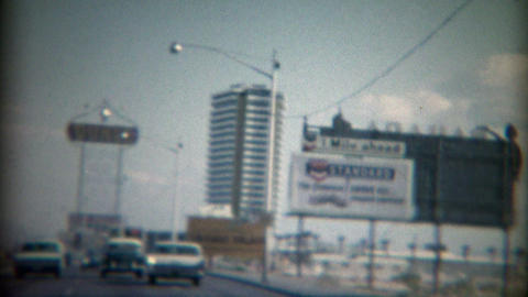 1965: TWA Jets road travel advertisement sign Caesars Palace Dunes Casino Footage