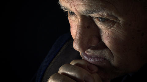 Desperate Old Man Praying In The Darkness: Dark Background, Loneliness, Sadness stock footage