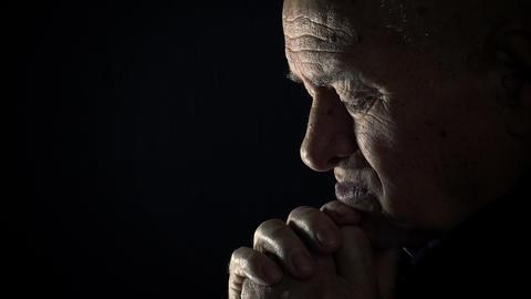sad old man praying in the darkness: sad old man, depressed old man, praying Live Action