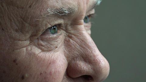 elderly man: old thoughtful man's look: senior man closeup portrait Footage