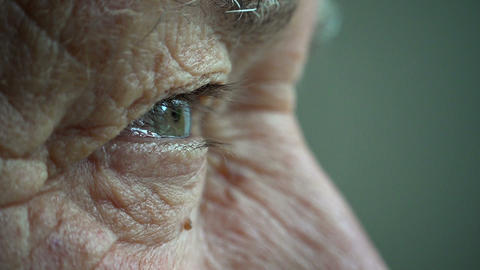 elderly man opens his eyes: old thoughtful man's eyes Footage