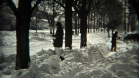 1936: Kids shoveling sidewalk snow after blizzard storm blankets home Footage