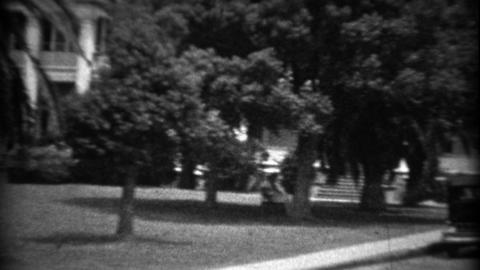 1934: Southern mansion home classic 1930's cars parked on street Footage