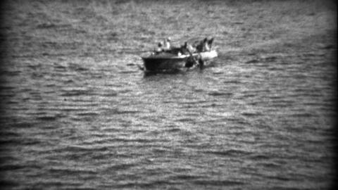 1934: Rescue lifesaving boat picks up drowning man in deep dark waters Footage