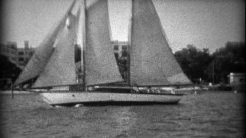 1934: Large 3 sailboat schooner across the pier event center and hillside mansio Footage