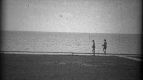 1934: Beach Pier Sandy View Gulf Coast Sandy Bay Waters stock footage