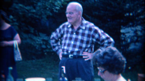 1965: Family summer outdoor socializing with alcohol ready on the picnic table Footage