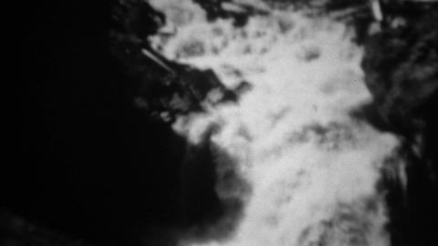 1937: Firehole Falls roaring river water tilt down to fast flowing waterfall Footage