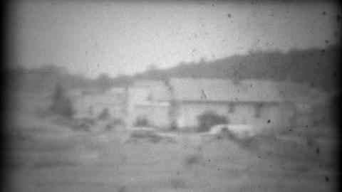 1937: Early car tourism driving through the center of town 1st person pov Footage
