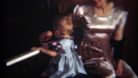 1954: Baby pounding on piano keys as mom tries to teach her subtlety Footage