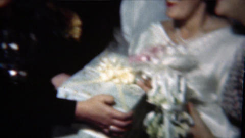 1954: Bride embarrassingly smiles while getting gift from loud mouth friend Live Action