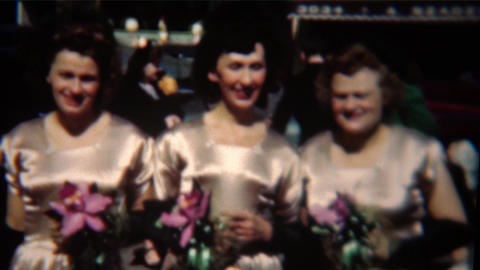 1954: Groom being funny at wedding sticks tongue out with grin mocking Footage