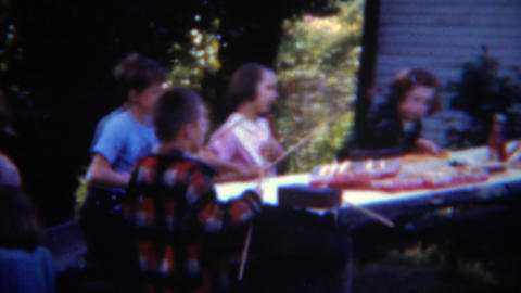 1953: Kids weenie roasting party hotdog condiments tables roasting party Live Action