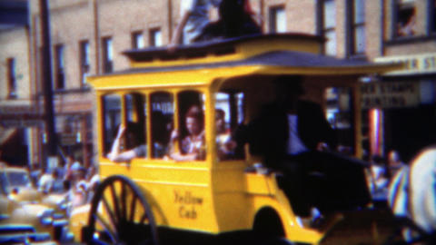 1951: Yellow cab taxi parade horse drawn carriage patriotic clown car Footage