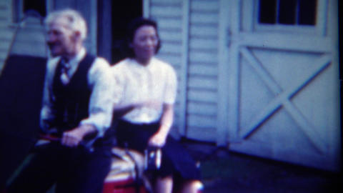 1949: Old man sits with Asian girlfriend and drives off old lady wife Footage