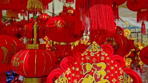 Wind Shakes Large Painted Chinese Lanterns on Street Market Footage