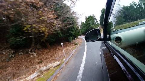 Side window view. The car is running the S-shaped corner of the low-speed Footage