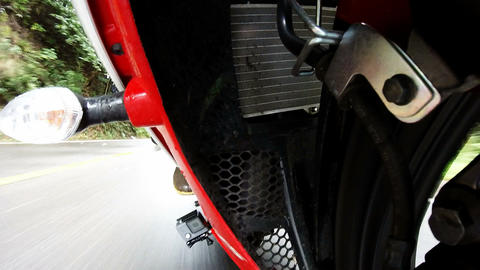 Front fork view. Bike running on a wet road Footage