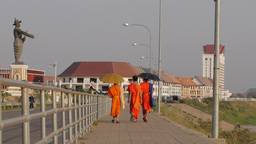 Monks Walking Down The Mekong Shore Road,Vientiane,Laos stock footage