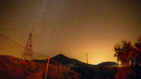 Timelapse night sky with milky way and mountain filmed on the countryside Footage