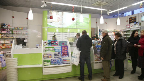 people near counter in pharmacy drugstore Footage