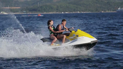 Happy couple riding jet ski Footage