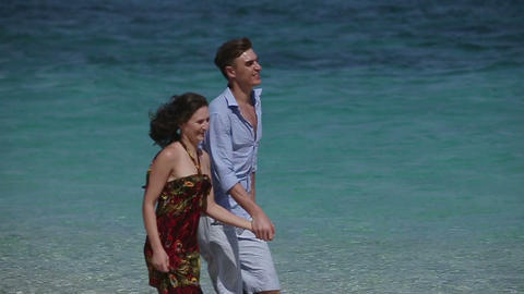 Happy Couple Running on Tropical Beach Footage