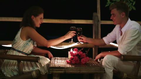Romantic couple having dinner, clinking glasses Footage