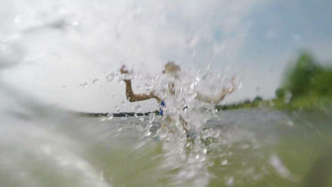 Young girl splashing the water in the lake Footage