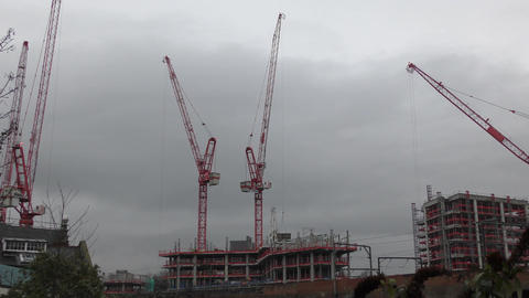 Construction cranes are building the building Live Action