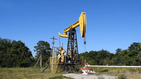 The pumping unit on a well. Equipment of oil wells Live Action